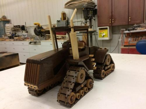 wooden tractor with working tread- toy replica