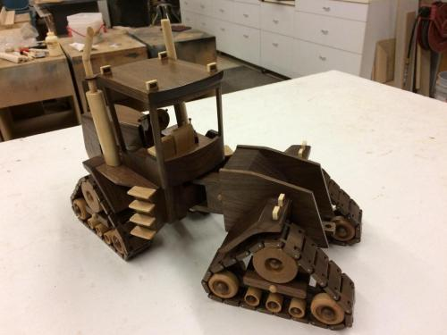 wooden tractor with treads and cabin - toy replicas